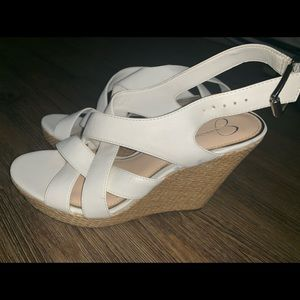 Worn only once. White wedges